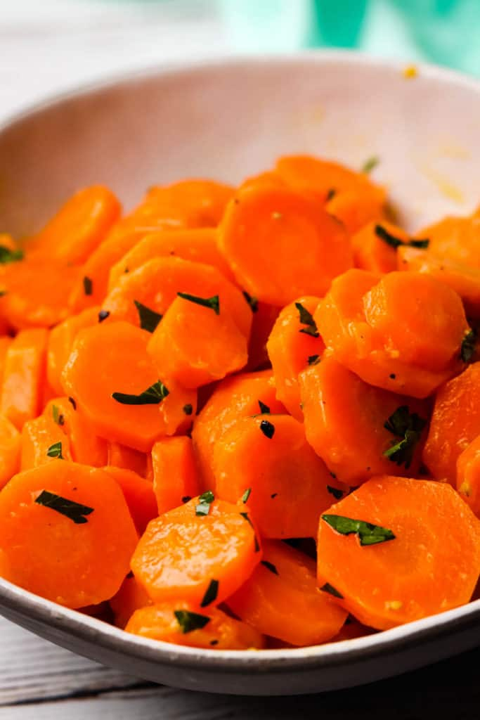 A closeup of carrots in a bowl.