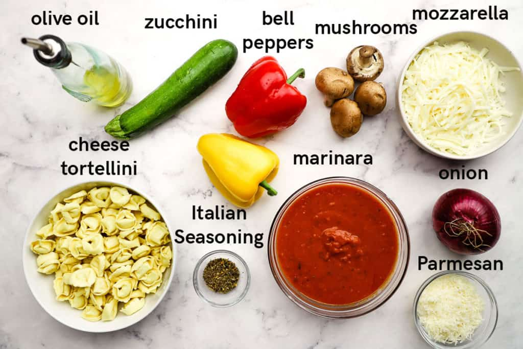 Labelled ingredients for making a baked tortellini casserole.