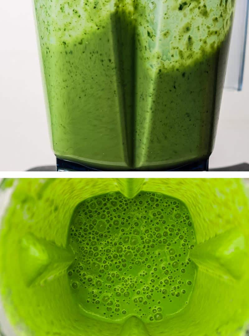 A green smoothie being blended in a high speed blender.