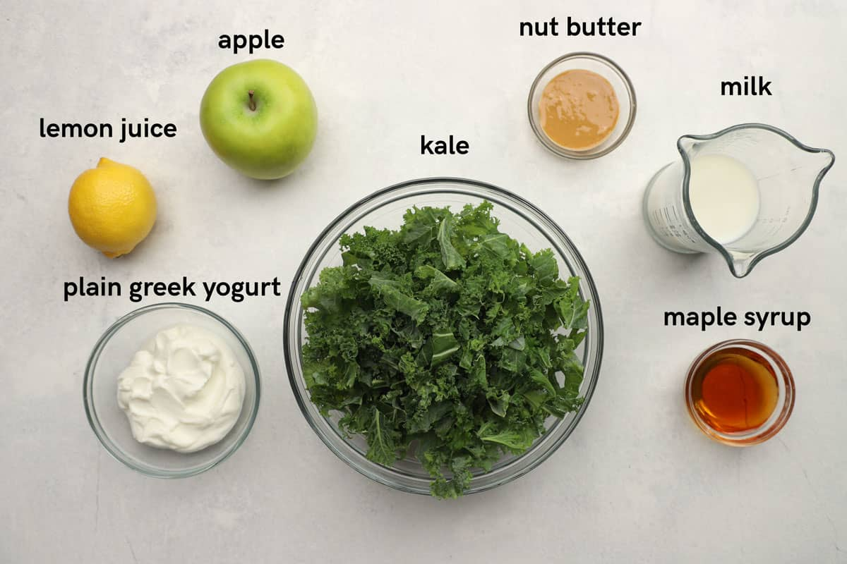 Labeled ingredients for making a kale apple smoothie